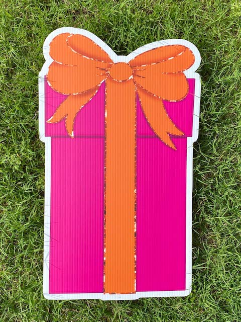 Pink gift with orange bow