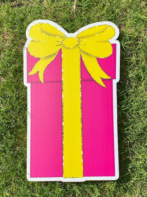 Pink gift with yellow bow