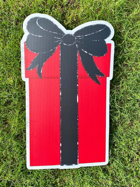 red gift with black bow