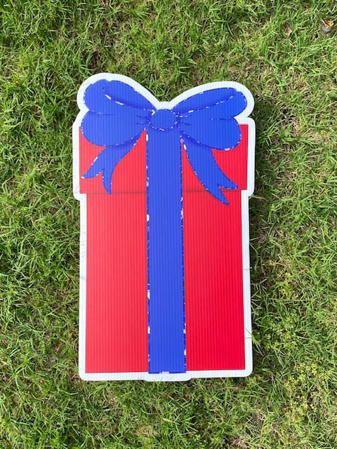 Red gift with blue bow